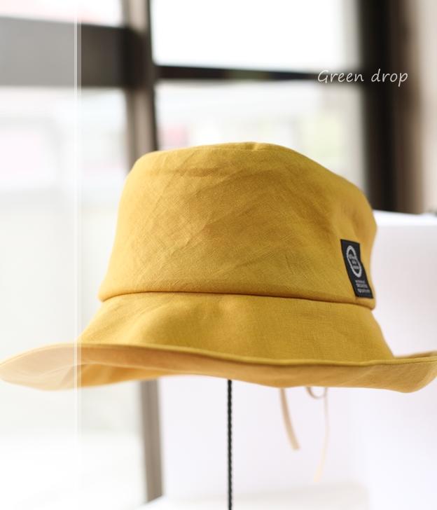 マスタードカラーのリネンのキャプリーヌ帽